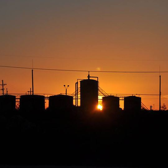 oil storage units in the sunset